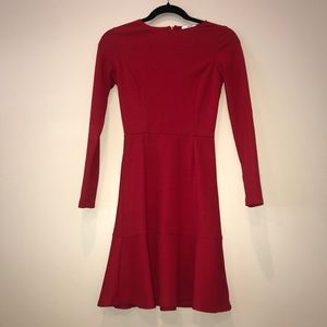 Red long sleeve fit and flare dress.